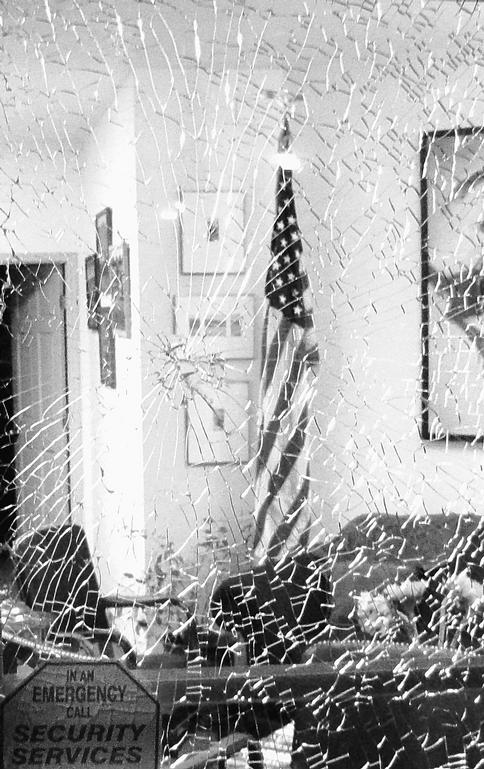The damaged front door to Rep. Gabrielle Gifford's office in Tucson, Ariz., is shown Monday a few hours after the House vote overhauling the nation's health care system.