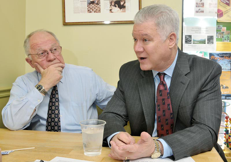 John Richardson, Democratic candidate for governor of Maine, explains what happened leading up to being denied Clean Election funding. He sits with friend F. Lee Bailey as he talks to a reporter in Brunswick.