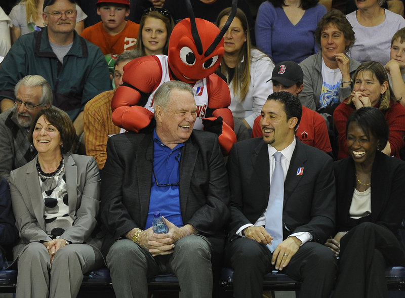 Tommy Heinsohn, the former Boston Celtics great, gets a rubdown from Red Claws mascot Crusher while sitting with D-League President Dan Reed during fan appreciation night at the Expo.