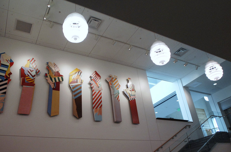 """""""Seven Sentinels,"""" a painted installation by Frederick Lynch, has been tidied up and relocated in better light at the Portland Public Library."""