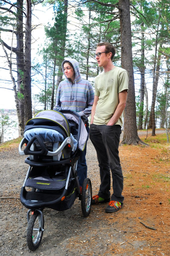 Julie Anderson and Tim Hofmann regularly bring their son, Henry, for walks on the trails of Mackworth Island. The two don't oppose a fee if it helps to fund the park system and improves the state's maintenance abilities.