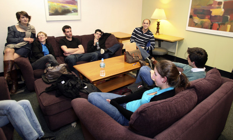 French students hang out in the School of Law lounge. They have visited Portland Head Light in Cape Elizabeth, eaten at various restaurants and homes, and found some great deals while shopping in Freeport.