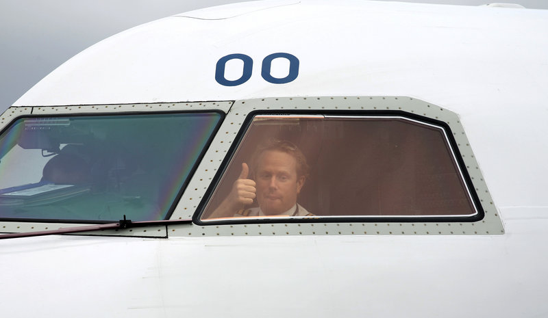 A pilot signals from the cockpit as he gets the go-ahead Tuesday to leave Belfast City Airport in Northern Ireland. Europe began allowing limited air traffic to resume, giving hope to commercial haulers and millions of travelers stranded around the world after an ash cloud from a volcano in Iceland choked jet traffic.