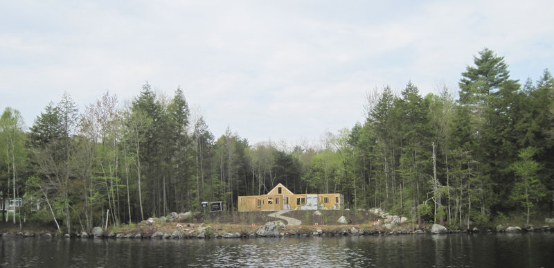 A photo taken Sunday shows replanting on a Long Lake property that was cleared of vegetation. The landowner's lawyer has said poor communication led to the clearing issues.