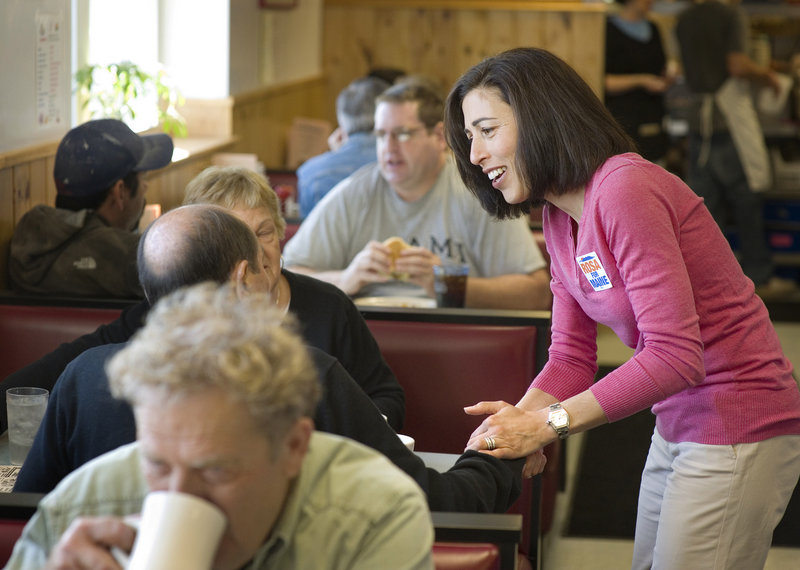 Candidate for governor Rosa Scarcelli visits with customers at Becky's Diner in Portland last week as she tries to build her name recognition among voters.