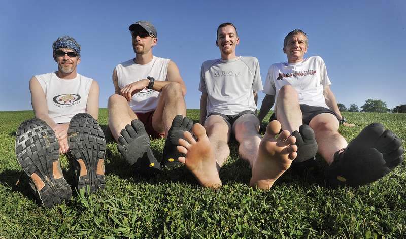 Trail Monsters Running members model footwear, including barefoot, likely to show up at the Pineland Farms Trail Running Festival. From left, Jeff Walker, Falmouth; Ian Parlin, Falmouth; Blaine Moore, Windham; Chuck Hazzard, Freeport.