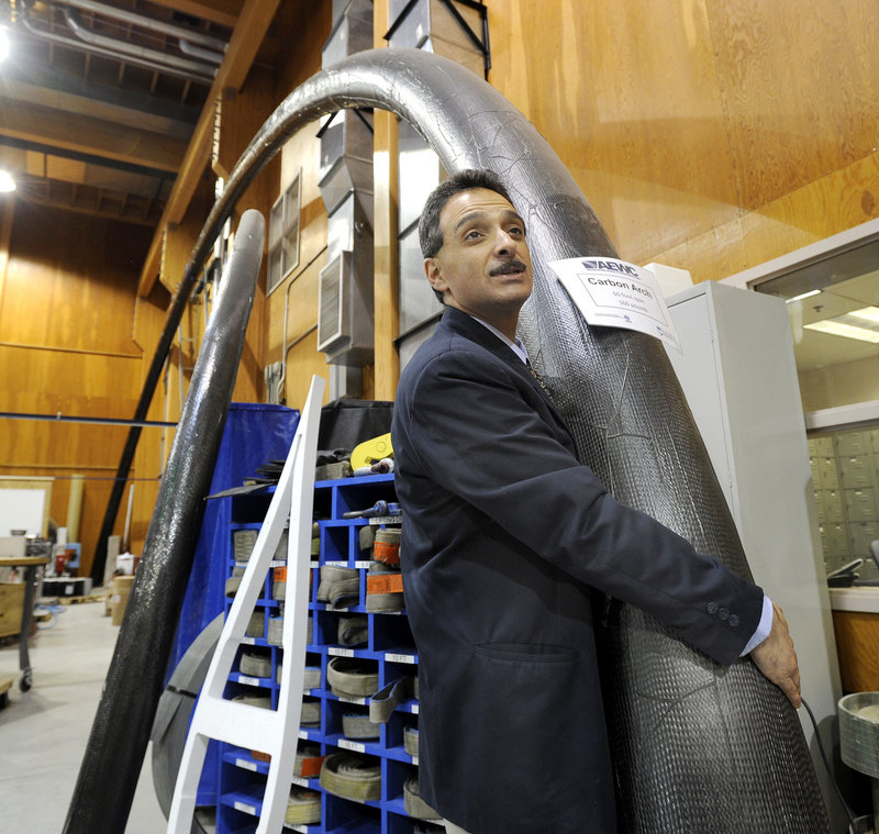 Habib Dagher, a founding director of the Advanced Structures and Composites Center at the University of Maine in Orono, easily hefts a composite tube used for bridge construction.