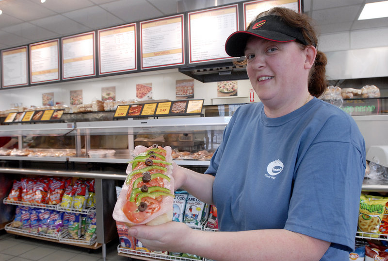 Founded in Portland in 1902, Amato's knows Italian food – one reason the chain of restaurants was voted Best Take-Out. Karen Sinclair displays a classic Italian sandwich.