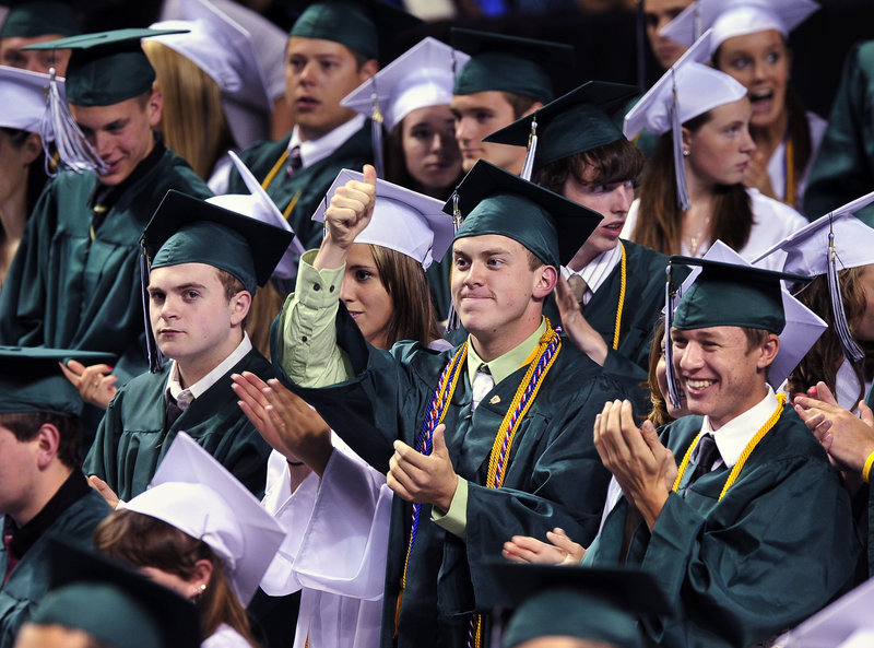 Surrounded by applauding classmates, class treasurer Robert Michaud gives the thumbs-up to class president K. Eliot Douin after his address at Bonny Eagle High School's graduation Friday at the Cumberland County Civic Center.
