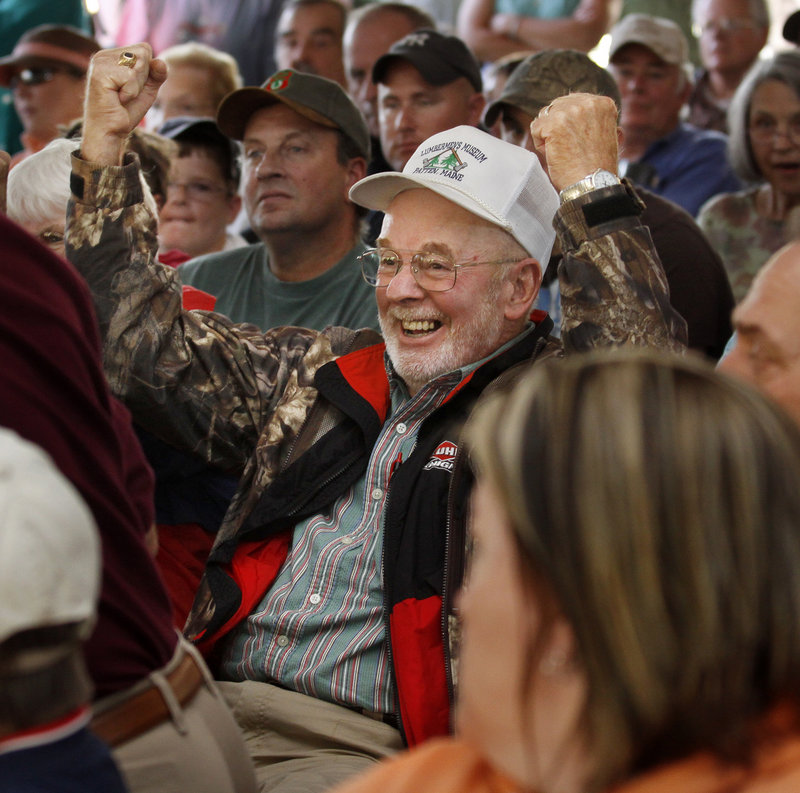 Ray Mitchison, 74, of North Chatham, N.Y., reacts as his name is called during the Maine moose lottery drawing on Thursday at L.L. Bean in Freeport. Mitchison has been waiting 20 years for his first permit in Maine.