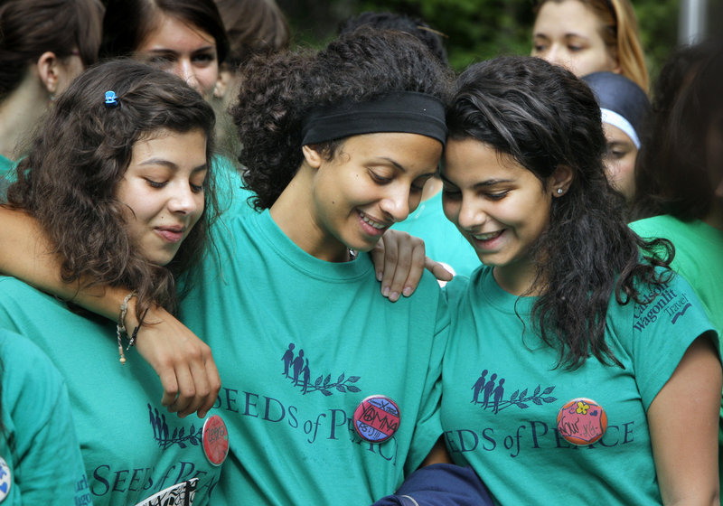 Zeena, left, Yomna and Nour listen during the Seeds of Peace opening ceremony. All three are with the Egyptian delegation, and Yomna and Nour are first-time campers.