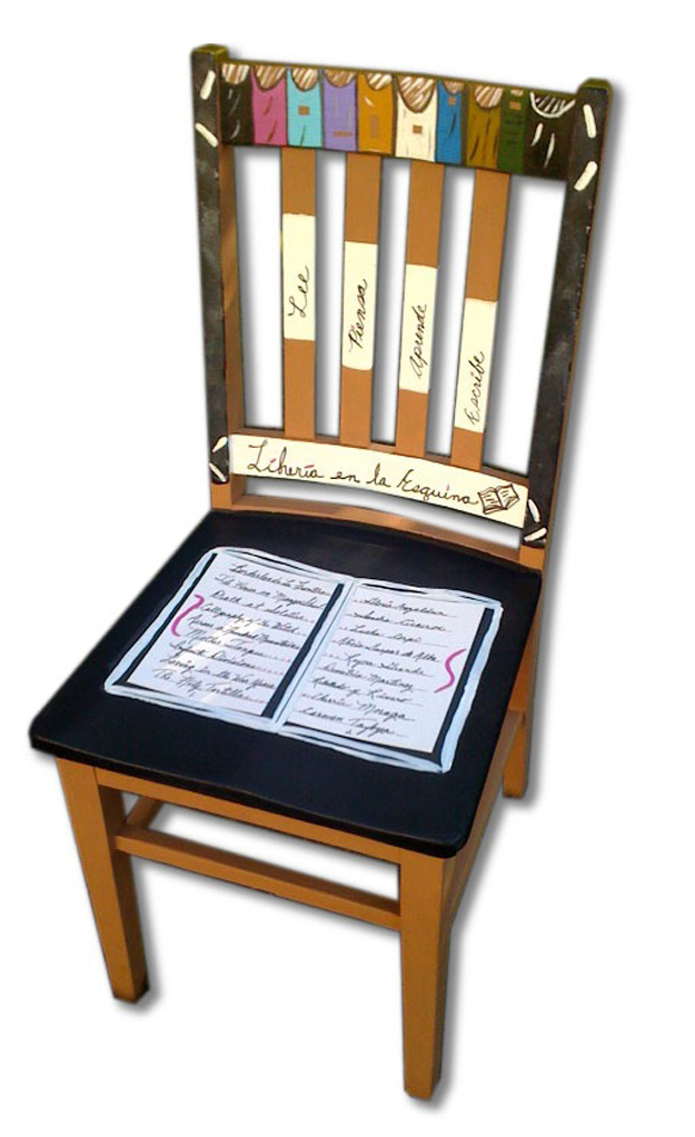 "This chair is titled ""Libreria en la Esquina,"" translated to ""Corner Bookstore."" The chair honors Chicana writers in the ""book"" on the seat."