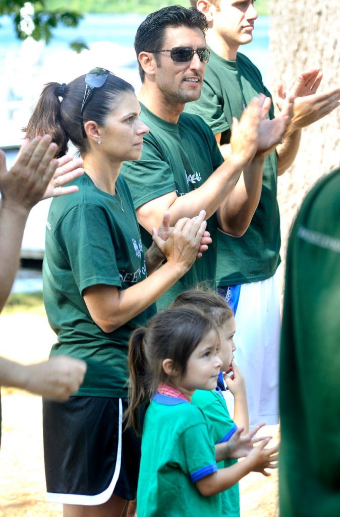 Mia Hamm stands with her husband, former Red Sox shortstop Nomar Garciaparra, and their twin 3-year-old girls, Ava and Grace, during Thursday's visit.