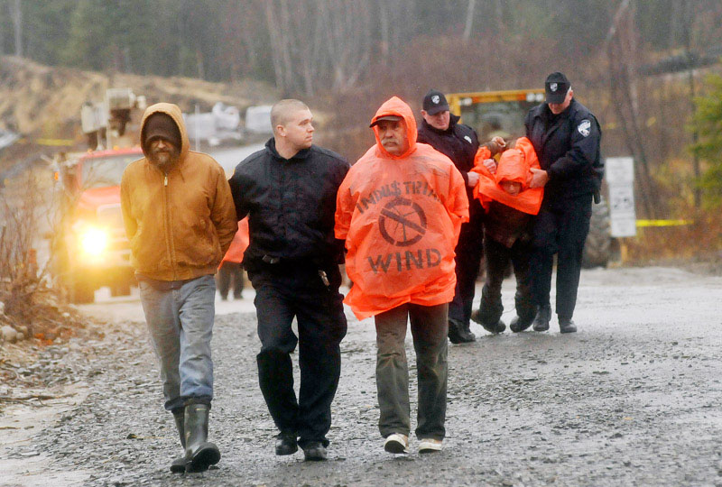 Protesters are arrested after blocking construction vehicles at the Rollins wind energy project in Lincoln today.