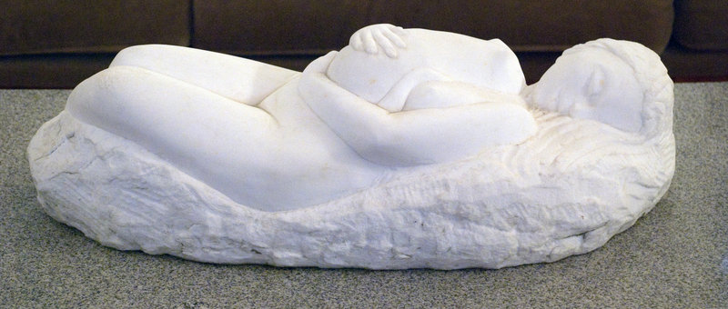 """Woman with Cat,"" marble, by Cabot Lyford, from the wide-ranging exhibition of his work displayed indoors and out at June LaCombe's Hawk Ridge Farm in Pownal."