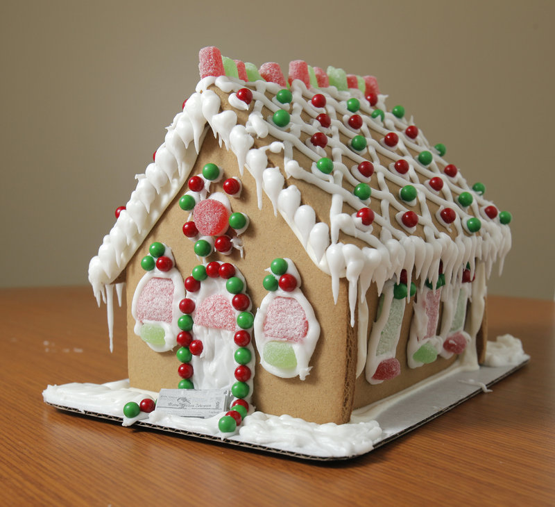 The Wilton gingerbread house, available at Hannaford and Walmart, was one of four assembled from kits by our columnist and presented to judges from our staff.
