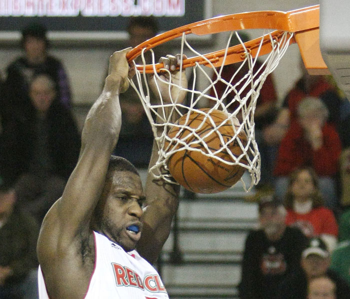 Champ Oguchi stuffs a shot during fourth-quarter action at Red Claws vs. Springfield Armor at the Portland Expo Sunday.