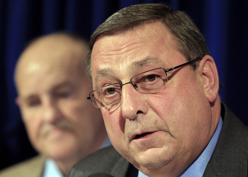 Maine Gov.-elect Paul LePage, right, announces members of his budget team at a State House news conference in Augusta, Maine, on Tuesday, Nov. 16, 2010. Sawin Millett, left, is a co-leader of LePage's budget advisors. (AP Photo/Pat Wellenbach)