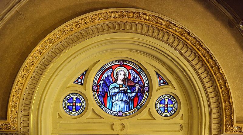 The 100-year-old church has stained glass windows and ornate architectural features.