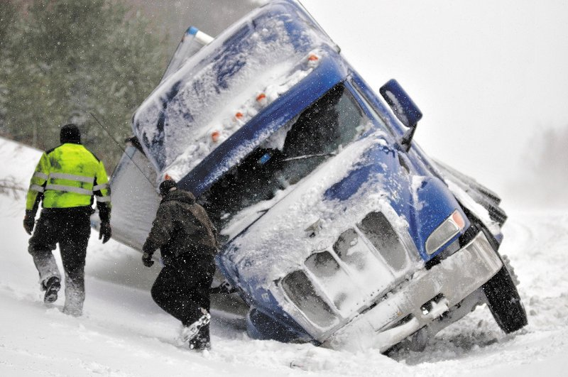Wrecker drivers work on pulling a truck from a ditch along Interstate 95 in Pittsfield, about five miles southwest of the Newport exit. No injuries were reported, and the truck was scheduled to be removed from the highway today.