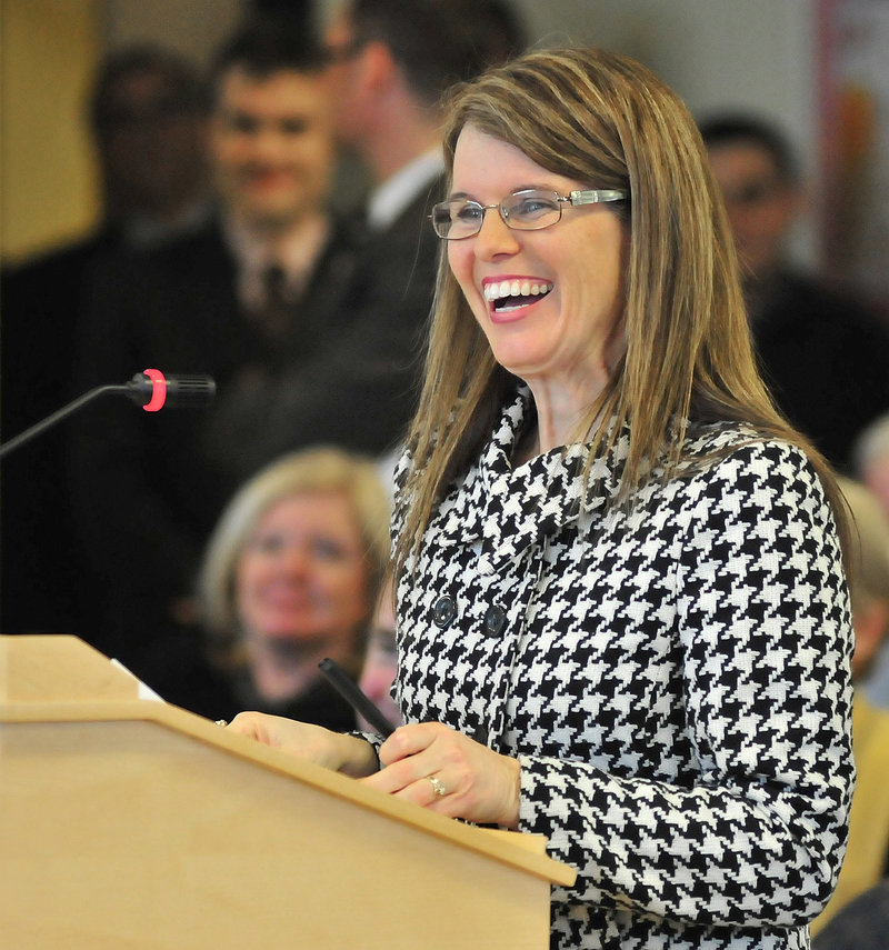 DHHS commissioner nominee Mary Mayhew shares a laugh with legislative committee members while testifying at a well-attended confirmation hearing Tuesday in Augusta.