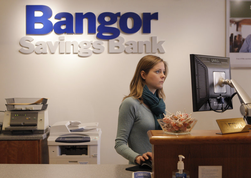 Megan Krispin works at Bangor Savings Bank in the Old Port earlier this month. She was hired when the branch opened in July as part of a $4 million expansion in southern Maine.