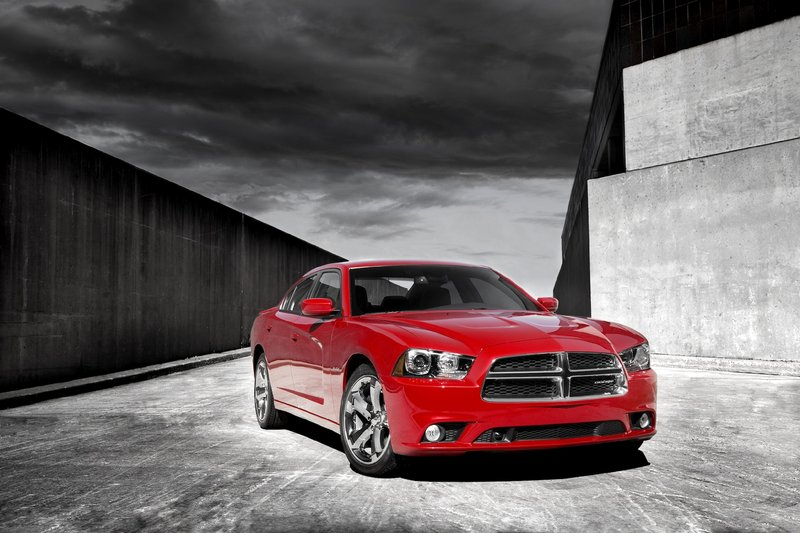 """Dodge's redesign of the Charger pays homage to the company's iconic 1968-70 model with styling cues such as its """"Coke-bottle"""" silhouette and the scalloped lines on its hood and flanks."""