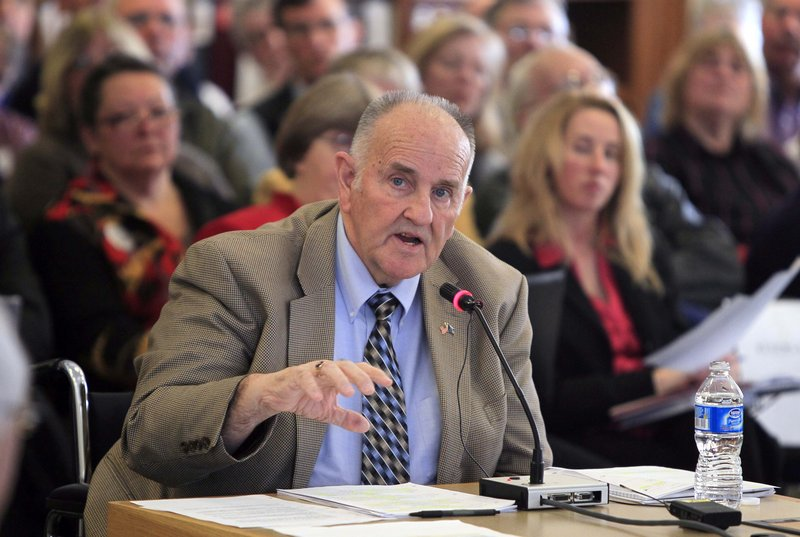 """State Finance Commissioner Sawin Millett testifies at a legislative budget hearing March 4 at the State House in Augusta. """"I knew this was a natural fit for me,"""" he said during a recent interview."""