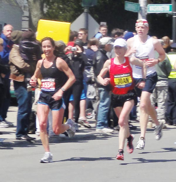 """Former Falmouth resident Kara Waters runs alongside Joan Benoit Samuelson at the Boston Marathon on Monday. Waters, who now lives in Baltimore, said a friend took the photo at mile 17. """"I was so thrilled to see her,"""" said Waters, who remembers attending one of Benoit's running camps as a 7th grader. """"She smiled and said, 'You are doing such a great time. Go get it.' Needless to say, she passed me at mile 18, but what an inspiration!"""" Happy to share more and kind of a once in a life-time photo op considering she hasn't run the marathon in years and heard there were a number of news segments about her running the marathon this year."""