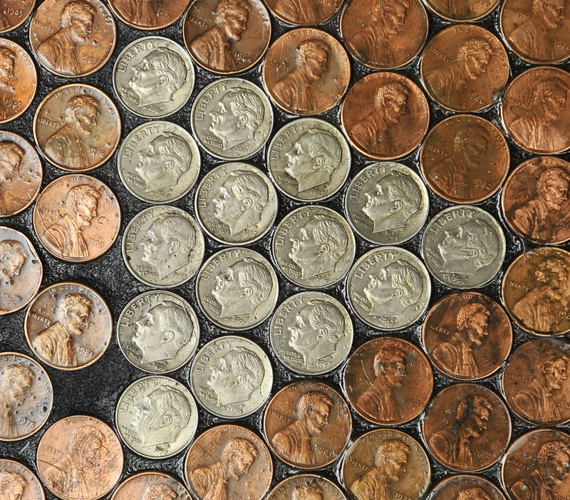Edwards' kitchen floor is mostly made of pennies – about 31,000 of them – but she added a few dimes here and there for interest.
