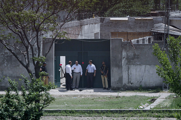 Pakistani security officials leave after the examining the house today where al-Qaida leader Osama bin Laden was killed in Abbottabad, Pakistan.