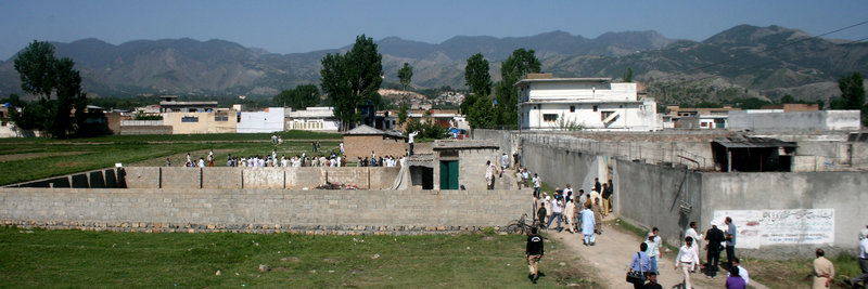 "Local residents and news media gather Tuesday at the compound and house, on right, of Osama bin Laden after authorities allowed people to approach the perimeter of the property in Abbottabad, Pakistan. White House counterterrorism adviser John Brennan said the U.S. already was scouring through items seized in the raid, including computers, DVDs and documents. There was ""more than we were expecting to find,"" said a U.S. intelligence official who insisted on not being named. ""There's written material, pictures – there's all kinds of stuff."""