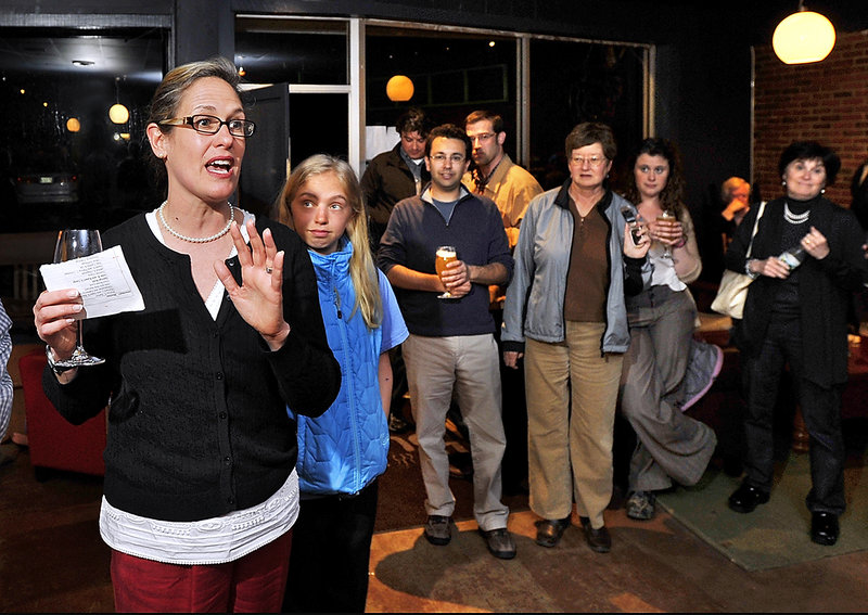 With her daughter Isabel Clarke, 14, by her side, Cynthia Dill announces her victory prospects at a party at The Buzz in Cape Elizabeth on Tuesday night.