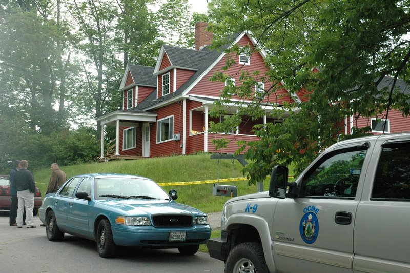 Police vehicles sit outside the Shore Road home in Dexter where Steven Lake is believed to have killed his estranged wife and children Monday. Amy and Steven Lake split up in 2010 and she had a restraining order against him, police said.