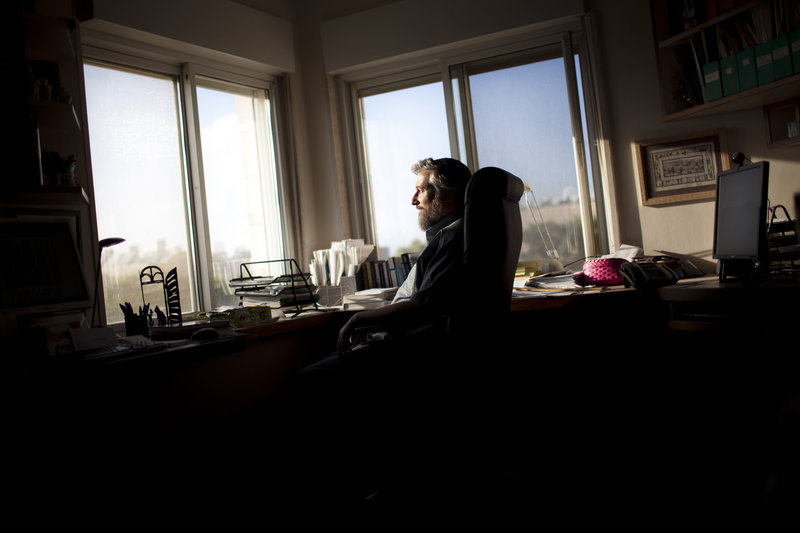 Computer science Professor Moshe Koppel of Bar Ilan University poses at his desk in the Jewish settlement of Efrata, near Bethlehem. Software developed by an Israeli team of scholars led by Koppel is giving intriguing new hints about what researchers believe to be the multiple authors who wrote the Bible.