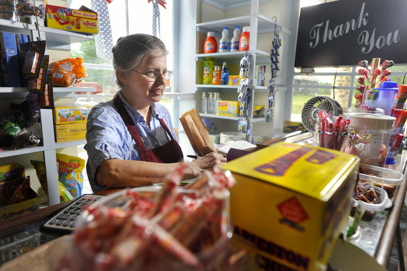 Bridget Scontras takes an order for candy from a customer. The Way Way Store reopened June 17 after being closed for eight years.