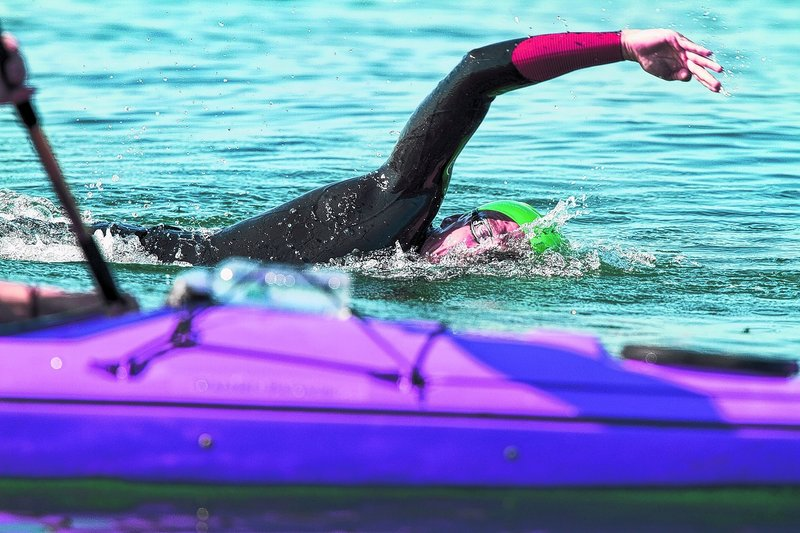 Scott Yeomans of Bethlehem, Pa., keeps his focus on his kayaker while heading toward the finish at East End Beach to win the 30th Peaks to Portland Swim.