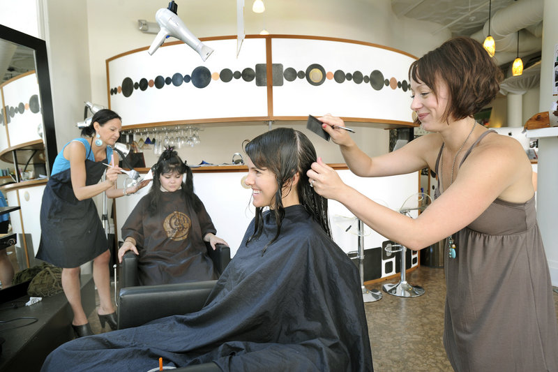 Stylist Jessica Parzych, right, takes care of Krista Wood of South Portland at Head Games Salon for Hair & Body in Portland, the readers favorite for best hair and nail salon.