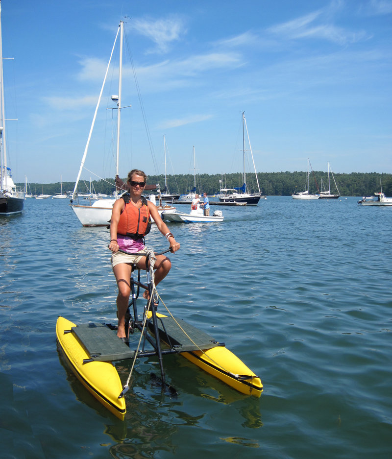 Jill Newel pedals a Hydrobike on the Harraseeket River in South Freeport, where the water-cycling craft are rented out by Ring's Marine Service.