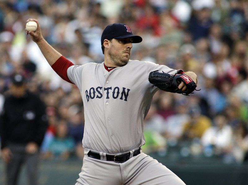 John Lackey, a key part of the pitching rotation for Boston's championship team last year, was traded to the St. Louis Cardinals on Thursday, with the Red Sox in last place in the American League East.
