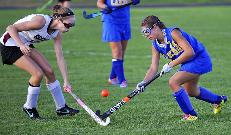 Kaley Sawyer of Greely, left, stops the forward progress of Lucy Fowler of Lake Region during their Western Maine Conference field hockey game Monday. Greely increased its winning streak to four games with a 3-1 victory at home.