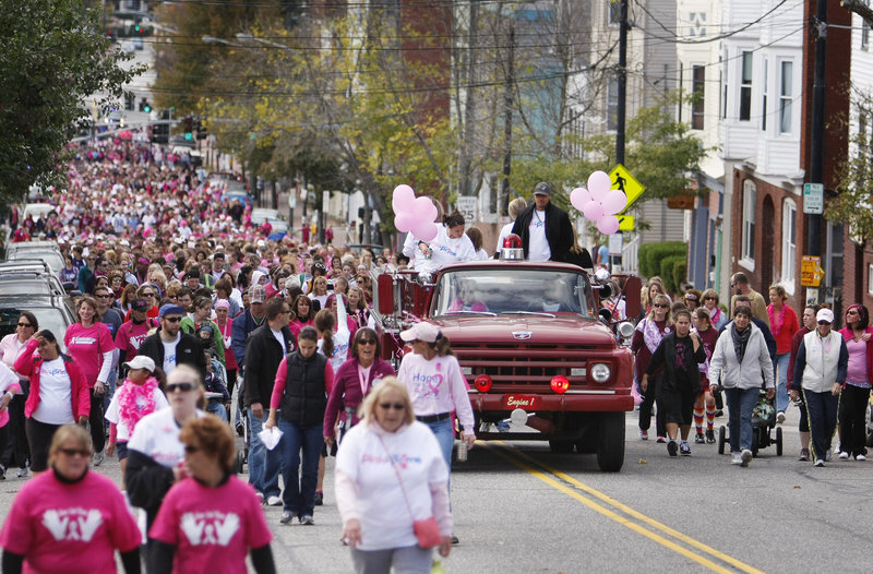 People taking part in the American Cancer Society's annual Making Strides Against Breast Cancer walk make their way up Congress Street to Munjoy Hill in Portland on Sunday. The event, which benefits research, education and patient support programs, drew nearly 2,000 people.