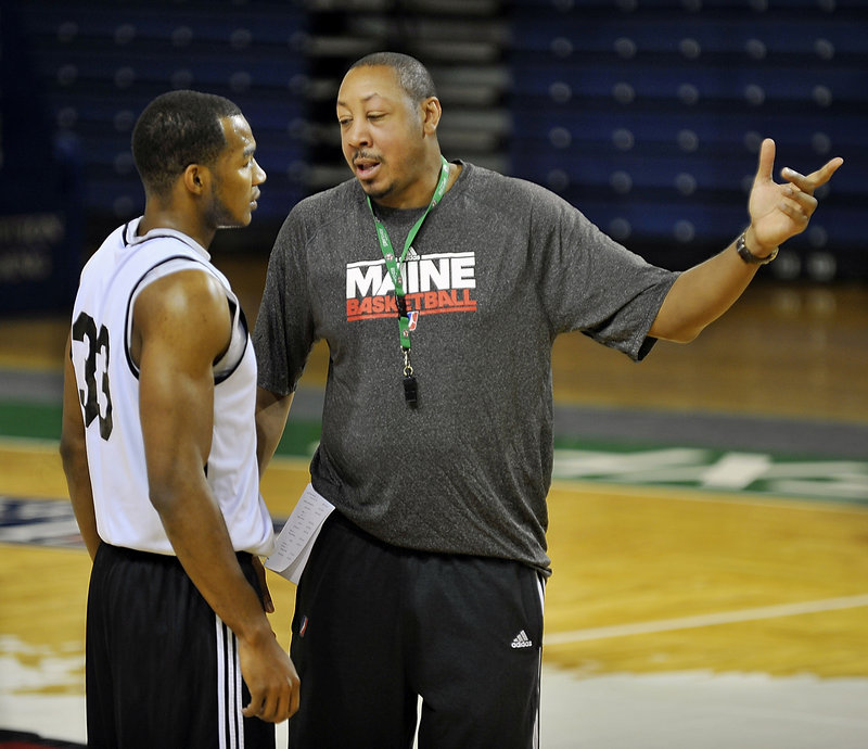 Chris Wright, left, who was the Red Claws' first pick in the draft, chats with assistant coach Donyell Marshall during a recent practice. Wright and teammate Kenny Hayes are best friends and cousins.