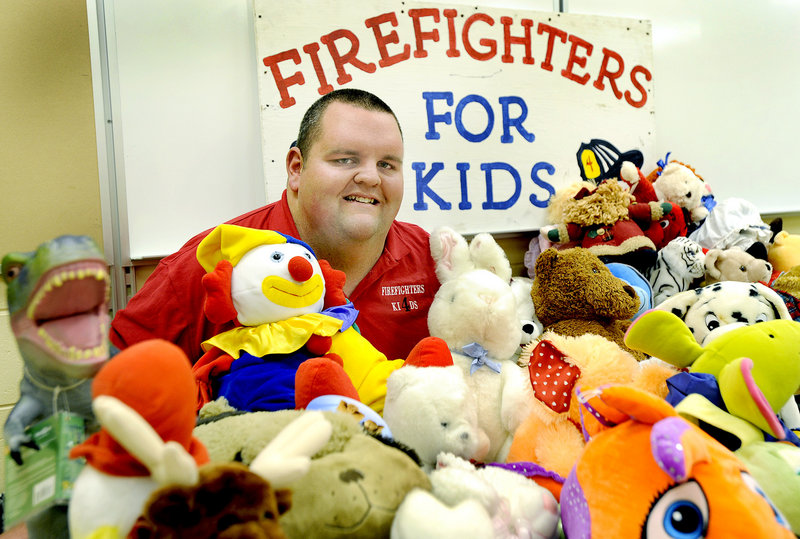 Kevin Foster is a Cumberland volunteer firefighter who started the Firefighters for Kids toy drive. He's shown with some toys to be given out this year.