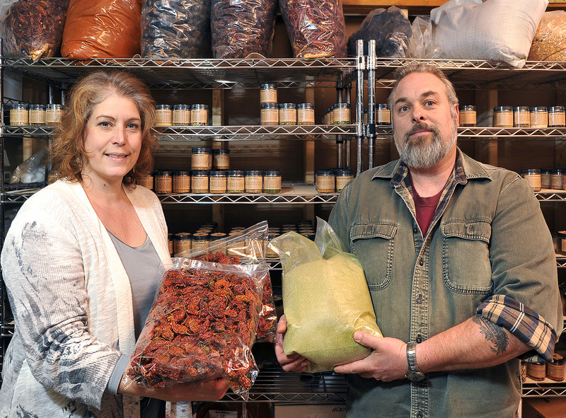 Christine Suydam displays super-hot ghost chiles while her husband Rick shows matcha (green tea) sea salt, one of 20 sea salts available from their Gryffon Ridge Spice Merchants. The company has sold more than 15,000 hand-packaged jars of spices this year.