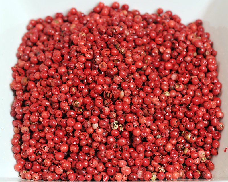 PINK PEPPERCORNS – Pink peppercorns are not actually peppercorns. They are the fruit of the baies rose plant, and are sweet, not peppery, in flavor. The Suydams suggest using them with pork, poultry, wine and cream sauces, seafood and vegetables. They have also used them in ice cream.