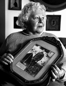 ELSIE SHEMIN-ROTH holds a photo father, William Shemin, taken during World War I, at her home in Labadie, Mo., on Jan. 5. Thanks to the tireless effort of his daughter and nearly four decades after his death, Shemin may finally be awarded the Medal of Honor for his actions. Many believe he never received the honor because he was Jewish.