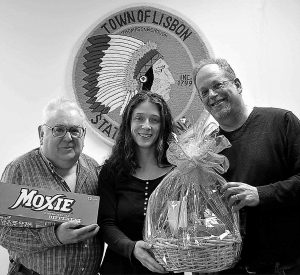 FRANK ANICETTI, left, owner of The Kennebec Store, poses with Melissa Pillsbury and Scott Benson, Lisbon's director of economic and community development, following the announcement that Pillsbury had won the 2012 Moxie Festival theme contest. This year's Moxie Festival will run July 13-15.