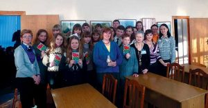 """Brunswick author Cynthia Lord, center in blue jacket, poses with Belarusian teachers during a recent U.S. State Department-sponsored trip to the former Soviet republic. The Newbery Honor-winning author signed a copy of her novel, """"Rules"""" — about a girl facing the challenges of having a younger brother with autism — has been translated into 10 languages and sold over 1 million copies."""