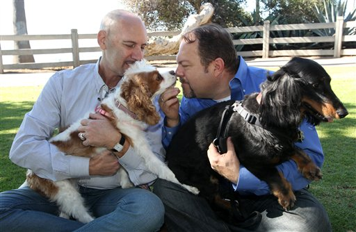 Steven May, left, holding his dog, Winnie, sitting with his attorney, David Pisarra and his dog Dudley in Santa Monica, Calif., recently. May, a pet consultant, hired Pisarra six years ago to handle his divorce.